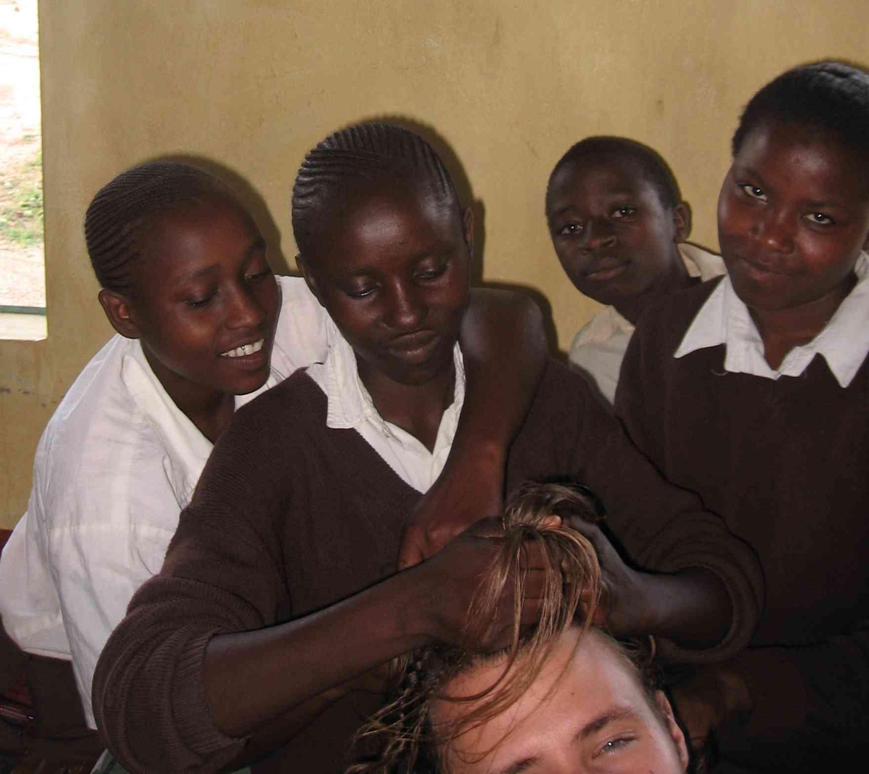 James's students at Mulundi-KwaMuema Secondary School Braid his hair