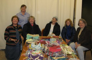 The Atrs and Crafts Guild at Saint John's Smiling and laughing as they complete over 700 pencil bags.