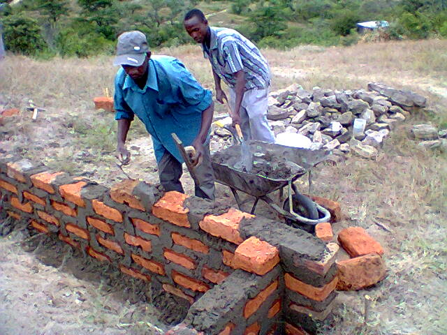 Men at work, Library Foundation wall.