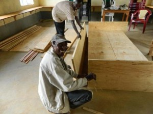Carpenter building bookshelves for Mulundi Community Library, Kitui, Kenya.